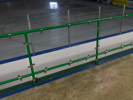 Railings with plexiglass installed between the pipes