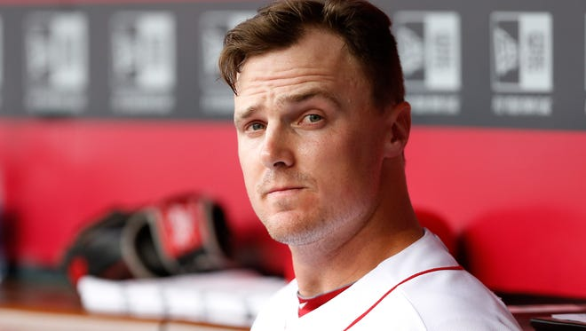 Jay Bruce sits in the dugout between innings during a game July 7 against the Chicago Cubs at Great American Ball Park.
