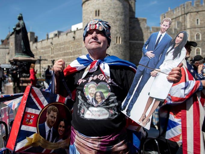 Royals fan John Loughrey poses with an assortment of