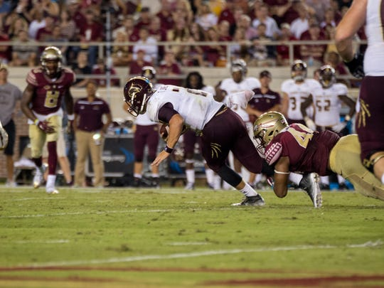 Defensive end DeMarcus Walker tackles Texas State QB Josh Sweat. FSU's defense wrecked havoc on the Bobcats offense all game.