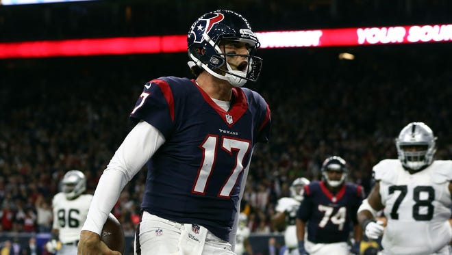 Houston Texans quarterback Brock Osweiler (17) runs the ball in for a touchdown during the fourth quarter of the AFC Wild Card playoff football game against the Oakland Raiders at NRG Stadium.