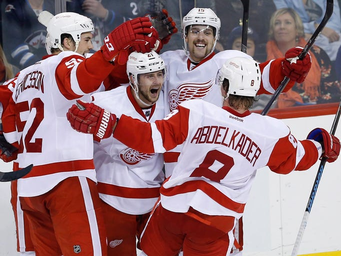 The Red Wings' Jonathan Ericsson (52), Tomas Tatar
