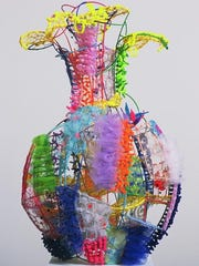 """Susan Spencer Crowe's """"Oh, Picasso, What a Vase!"""" incorporates pieces of chicken wire, paint, fabric and tulle netting,"""