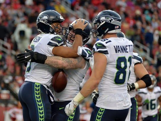 Seattle Seahawks quarterback Russell Wilson, left,