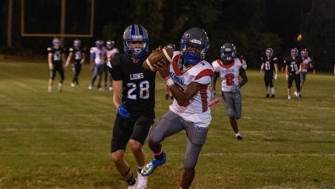 Memorial Day's Sean Stoddard (3) makes an interception in the end zone against St. Andrew's School's Anthony Kusilka (28) on Friday night at St. Andrew's School.