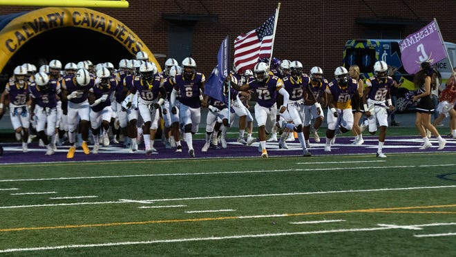 The Calvary team takes the field before a game against Frederica Academy on Sept. 18.