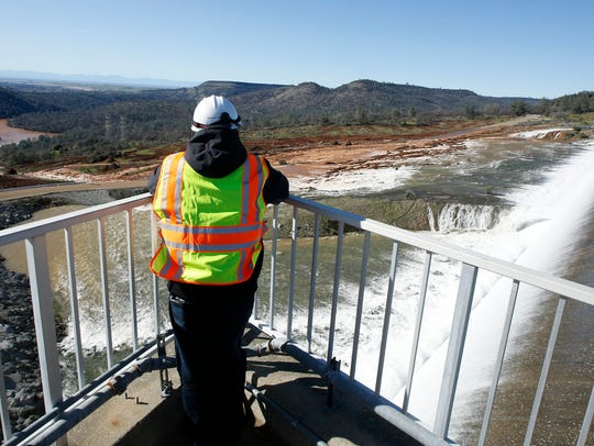 A employee of the Department of Water Resources watches