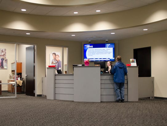 A customer is helped at the new MutualBank on West
