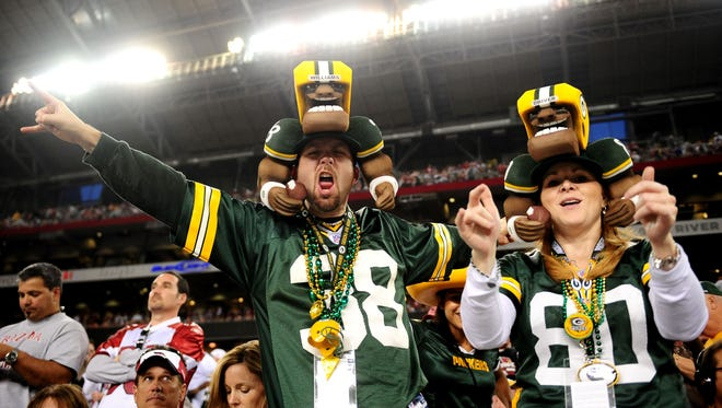 Green Bay Packers fans cheer against the Arizona Cardinals in the 2010 NFC wild card playoff game at University of Phoenix Stadium. Arizona defeated Green Bay 51-45.