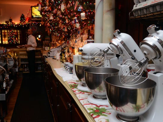 Mixers for whipping eggs sit at the as the Brass Rail kicked off the Tom and Jerry season Friday in Port Huron. The Brass Rail in downtown Port Huron has been offering the Tom and Jerry during the holiday season for 75 years.
