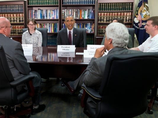 "Barack Obama, Judy Fisher, Marvin Lance Futch, Rep. Rob Bishop, R-Utah, Harry  ""Buddy"" Briesmaster III, Sen. Orrin Hatch, R-Utah, and Michelle Fisher."