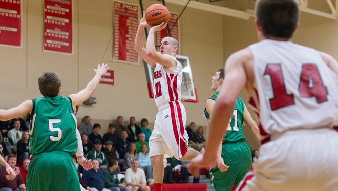 St. Philip's Hunter Haley takes a jump shot against Mendon on Monday.