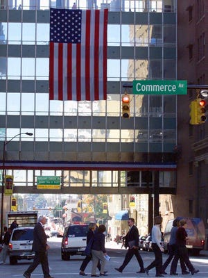 A large U.S. flag greets furniture buyers in 2001 as they walk from one of the showrooms at the International Home Furnishings Market in High Point, N.C.