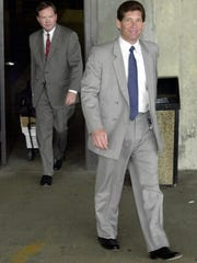 Michael DiLeonardo (right), accused of being a member of the Gambino crime family, followed by his attorney Craig Gillen.