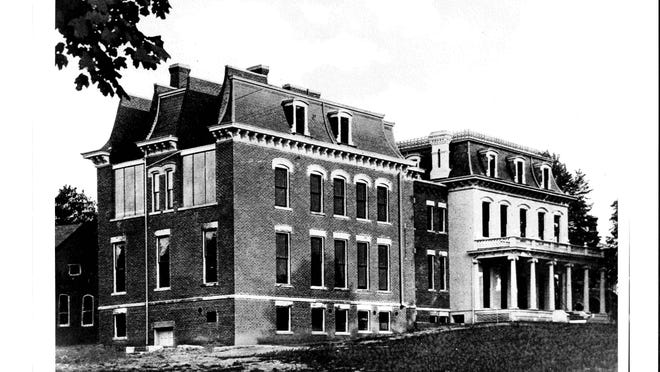 The Emma L. Bixby Hospital as it appeared when it opened in 1911. The addition to the hospital can be seen just north of the original Crocker residence (white building to the right). The hospital was located on the northeast corner of East Maumee and North Locust Streets, on the site now occupied by the Adrian Post Office.