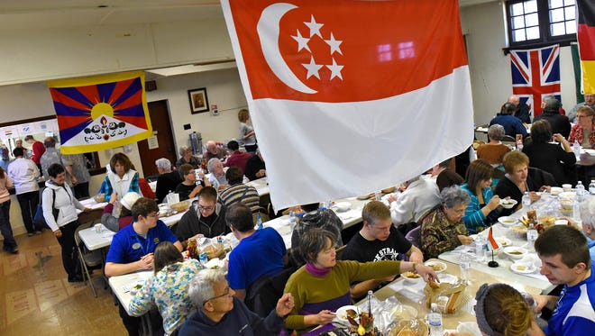 People enjoy many varieties of soup under flags representing each soup's origin during Saturday's International Soup Luncheon at Holy Myrrh-bearers Orthodox in St. Cloud. This year's event featured soups from seven countries.