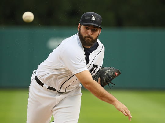 Michael Fulmer of the Detroit Tigers warms up before