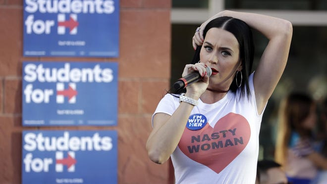Singer Katy Perry speaks at a rally in support of Democratic presidential nominee Hillary Clinton, Saturday, Oct. 22, 2016, in Las Vegas.