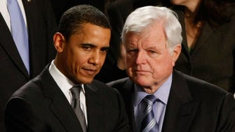 Sen. Barack Obama confers with Sen. Edward Kennedy before the State of the Union speech by President George W. Bush in 2008.