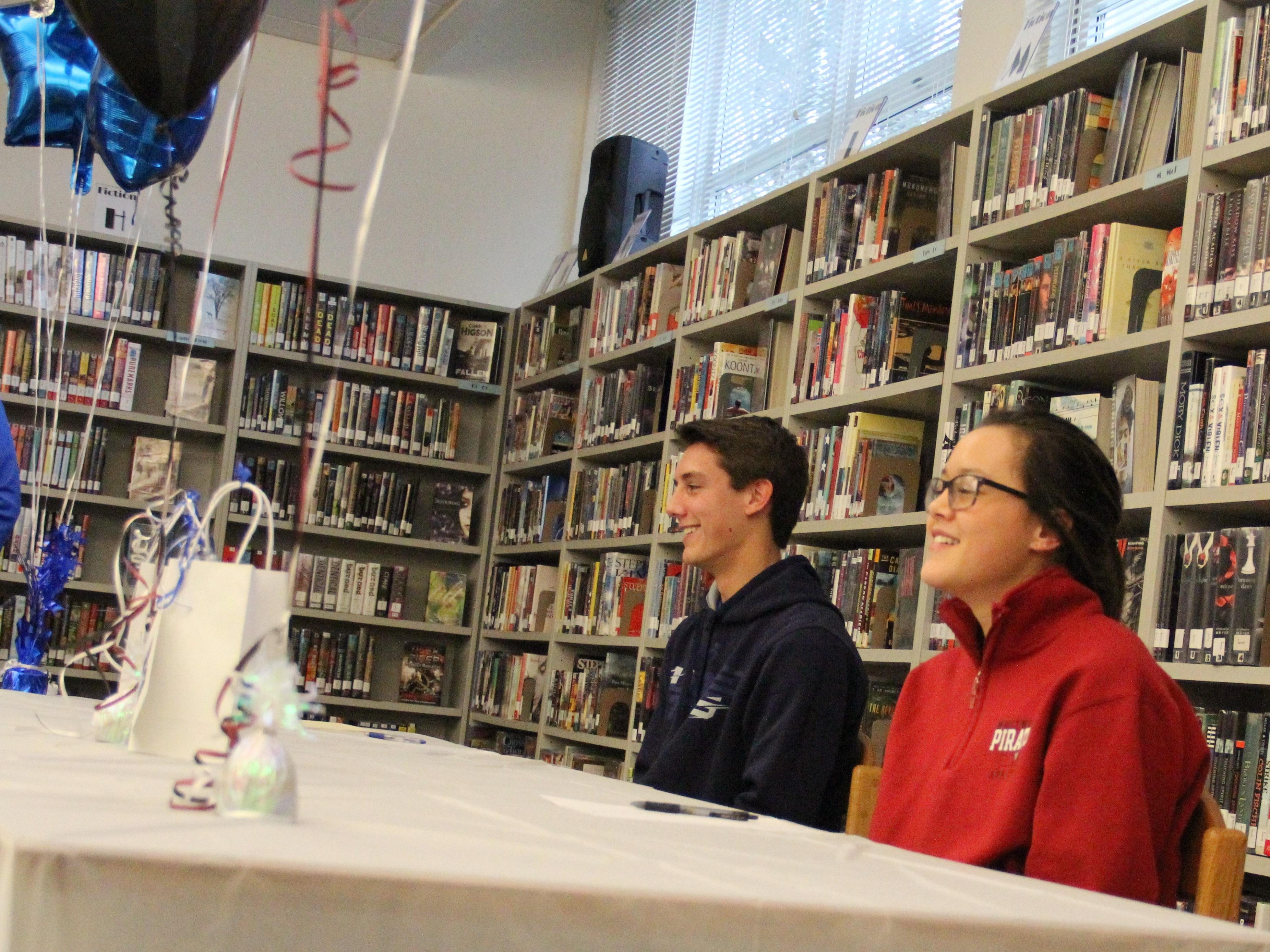 McNary senior Matt Aguilar (left) and Kinsey McNaught at a signing ceremony on Friday, January 15, 2016.