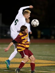Vestal's Corey Barr and Ithaca's Mason Todhunter try to gain control of the ball during the STAC final on Monday, October 16, 2017 at Vestal.