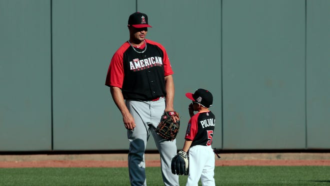 Albert Pujols with his son during workout day before the 2015 MLB All Star Game at Great American Ballpark.