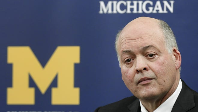 Former Steelcase CEO Jim Hackett listens to a question after being introduced as the University of Michigan's interim athletic director during a news conference in Ann Arbor, Mich., Friday, Oct. 31, 2014. University of Michigan President Mark Schlissel announced that athletic director Dave Brandon resigned. (AP Photo/Paul Sancya)
