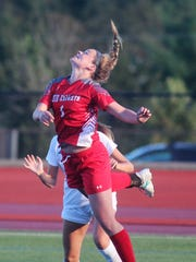 Dixie Heights freshman Carson Smith leaps for the ball during the Ninth Region girls soccer semifinals Oct. 18, 2017 at Dixie Heights High School. Notre Dame beat Dixie Heights 2-0 and St. Henry beat Highlands 2-0 in penalty kicks after a 0-0 tie.