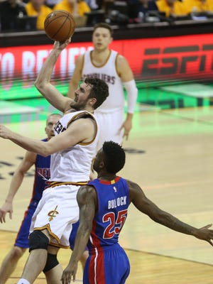 Detroit Pistons' Reggie Bullock defends against the Cleveland Cavaliers' Kevin Love on Sunday, April 17, 2016 at Quicken Loans Arena in Cleveland.