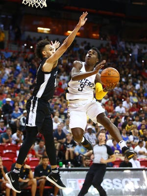 FILE -- Indiana Pacers guard Aaron Holiday (3) against San Antonio Spurs guard Derrick White (4) during an NBA Summer League game at the Thomas & Mack Center.