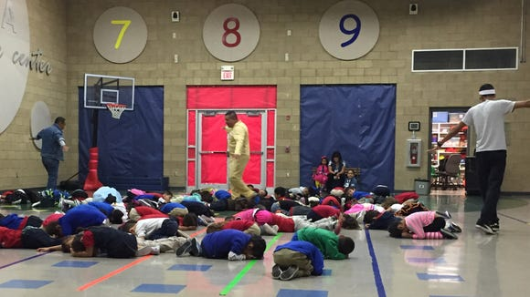 Young students pretend to be crabs hiding from seagulls during physical education at the Ysleta Pre-K Center on Oct. 8.