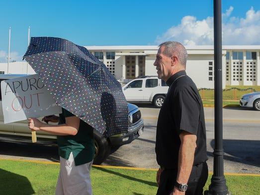 Coadjutor Archbishop Michael Byrnes momentarily walks