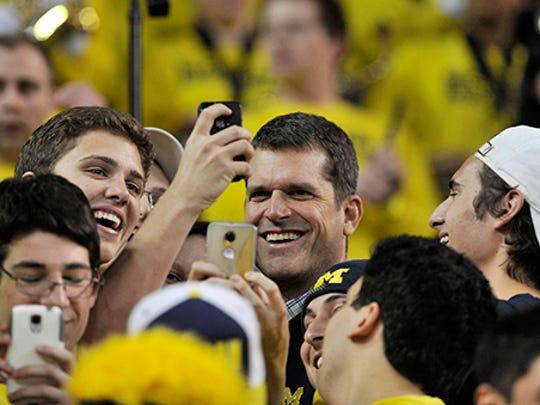 Jim Harbaugh is a frequent visitor to Michigan sports