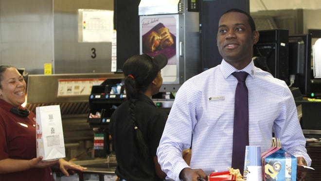 McDonald's manager Steven Chappell searches for the owner of a Happy Meal and other items Tuesday at the store at Colonial Boulevard and State Road 82 in Fort Myers Tuesday.