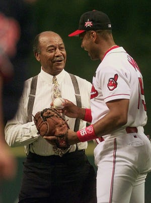 Larry Doby accepts a ball from Cleveland Indians catcher Sandy Alomar prior to the start of the 68th All-Star Game July 8, 1997, in Cleveland. Doby, heralded for more than a half-century as the first black player in the American League, was elected to the Baseball Hall of Fame Tuesday, March 3, 1998.
