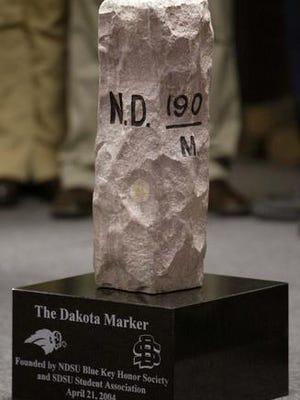 SDSU and NDSU play football for the Dakota Marker trophy.