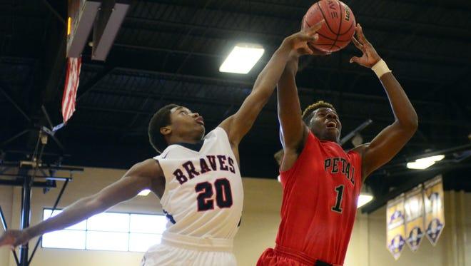 Petal High School senior  Tirus Smith reaches for the basket against South Jones in the Hattiesburg Coca-Cola Tournament on Thursday.