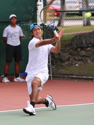 In this file photo, Guam's Danny Llarenas plays a forehand return to No. 7 Bumpei Sato of Japan during Round 2 of the 2013 edition of the Guam F1 Futures tennis tournament, an ITF Pro Circuit event currently called the King's Guam Futures tennis tournament presented by Hilton Guam Resort & Spa and Docomo Pacific, at the Hilton Guam Resort & Spa tennis courts. Llarenas has been selected to play in Guam's debut in the Davis Cup by BNP Paribas in Oman in January.