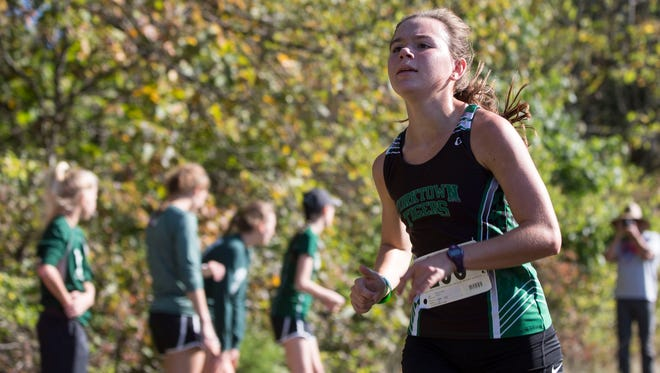 Yorktown's Indira Brown, shown here during cross country regionals last fall, was part of three winning relay teams at the Marion Relays on Saturday.