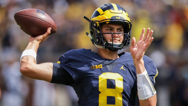 Michigan Wolverines quarterback John O'Korn warms up before the opener against Hawaii at Michigan Stadium in Ann Arbor on Sept. 3, 2016.