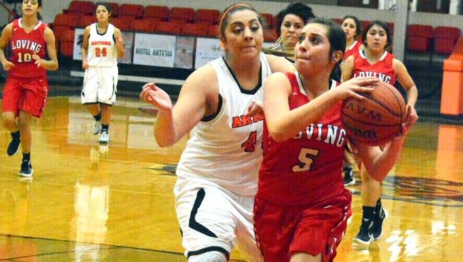 Loving freshman guard Anyssa Rodriguez attacks the basket in the the fourth quarter Monday at Artesia JV.