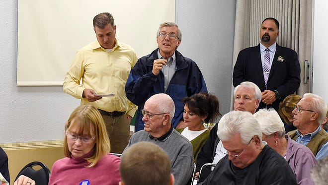 Tony Hansen, a faculty member at St. Cloud State University, questions the St. Cloud school district referendum during a forum Oct. 5 at the Whitney Senior Center.