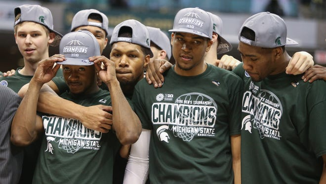 Michigan State Spartans raise the Big Ten Tournament trophy after beating the Purdue Boilermakers 66-62 on Sunday, March 13,2016 at Bankers Life Fieldhouse in Indianapolis Indiana.