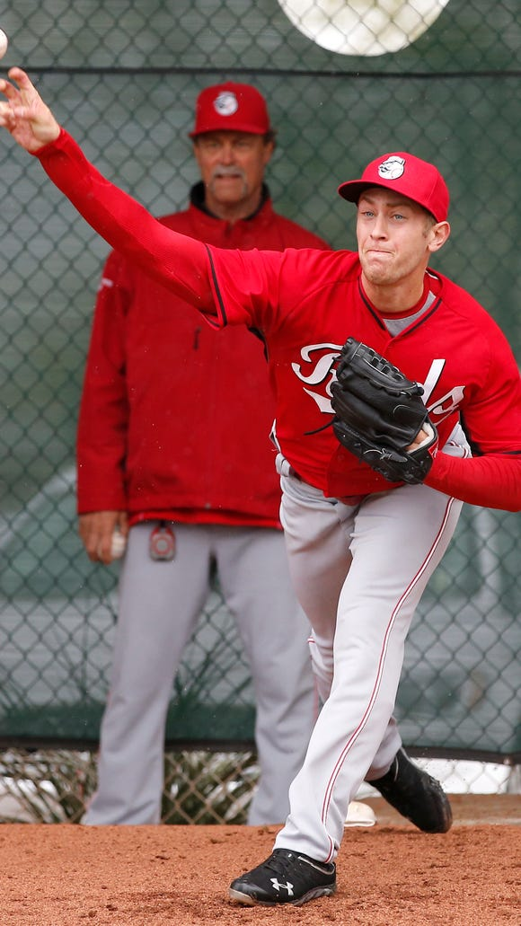 Non-roster invitee pitcher Jon Moscot throws during