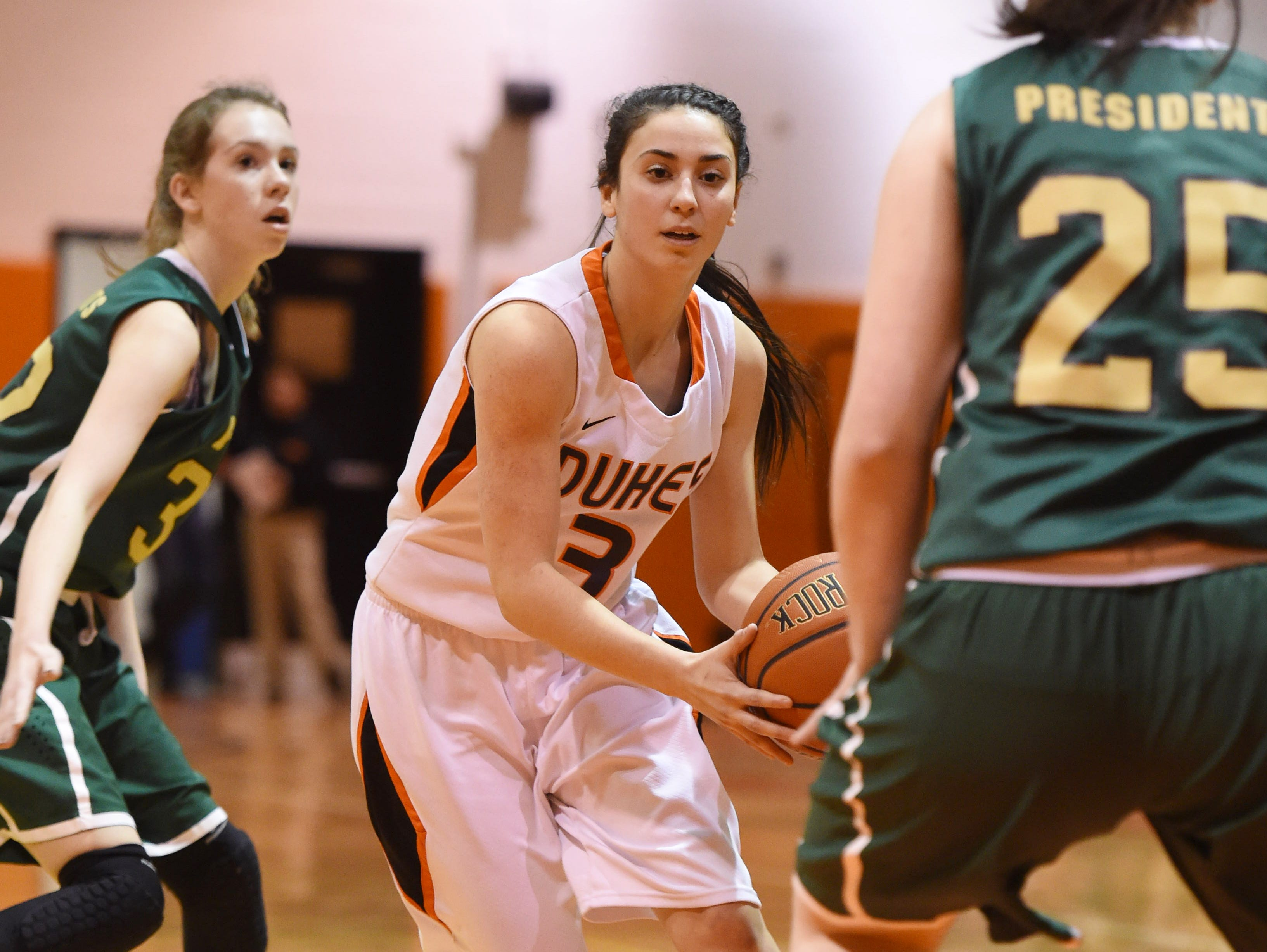 Marlboro's Taylor Felicello dribbles between two Roosevelt defenders during a game last February.
