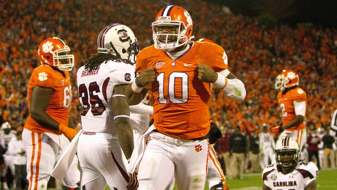 Clemson Tigers quarterback Tajh Boyd (10) celebrates a touchdown during the first quarter of the game against the South Carolina Gamecocks at Clemson Memorial Stadium in 2012.