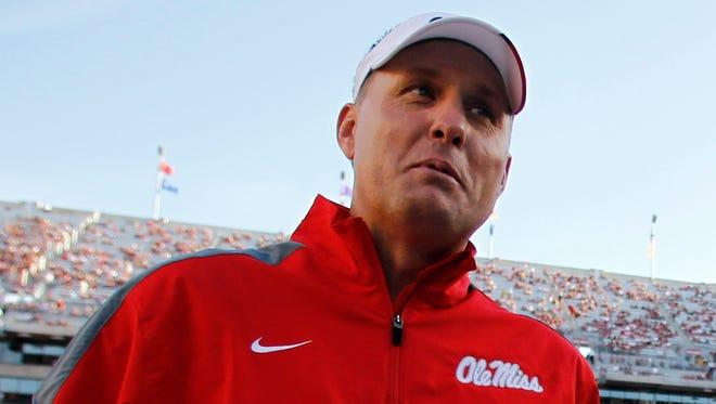 Ole Miss coach Hugh Freeze takes on his good friend, Auburn coach Gus Malzahn, Saturday night.