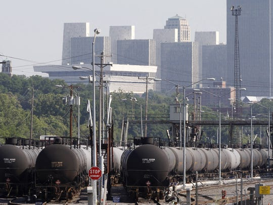 In this July 16, 2013, file photo, railroad oil tankers