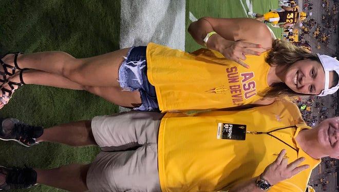 Ruby Martin poses with ASU head coach Bob Bowman at a Sun Devils football game during Martin's official visit.