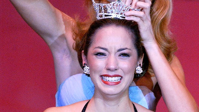 Miss Wisconsin 2003 Tina Sauerhammer gets emotional as Miss Wisconsin 2002 Jayme Dawicki, right, pins the crown during the Miss Wisconsin Pageant on Saturday, June 21, 2003 at Alberta Kimball Auditorium in Oshkosh, Wisconsin.